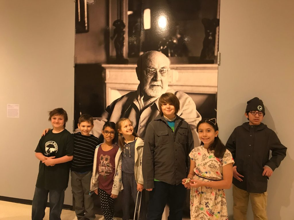 After a Matisse unit in art class students pose with a great photo of Henri Matisse, French artist, at the Albright Knox Art Gallery