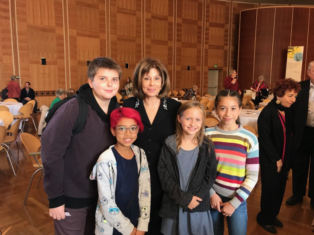 Mandala students pose with JoAnn Falletta, Director of the Buffalo Philharmonic Orchestra, before a concert