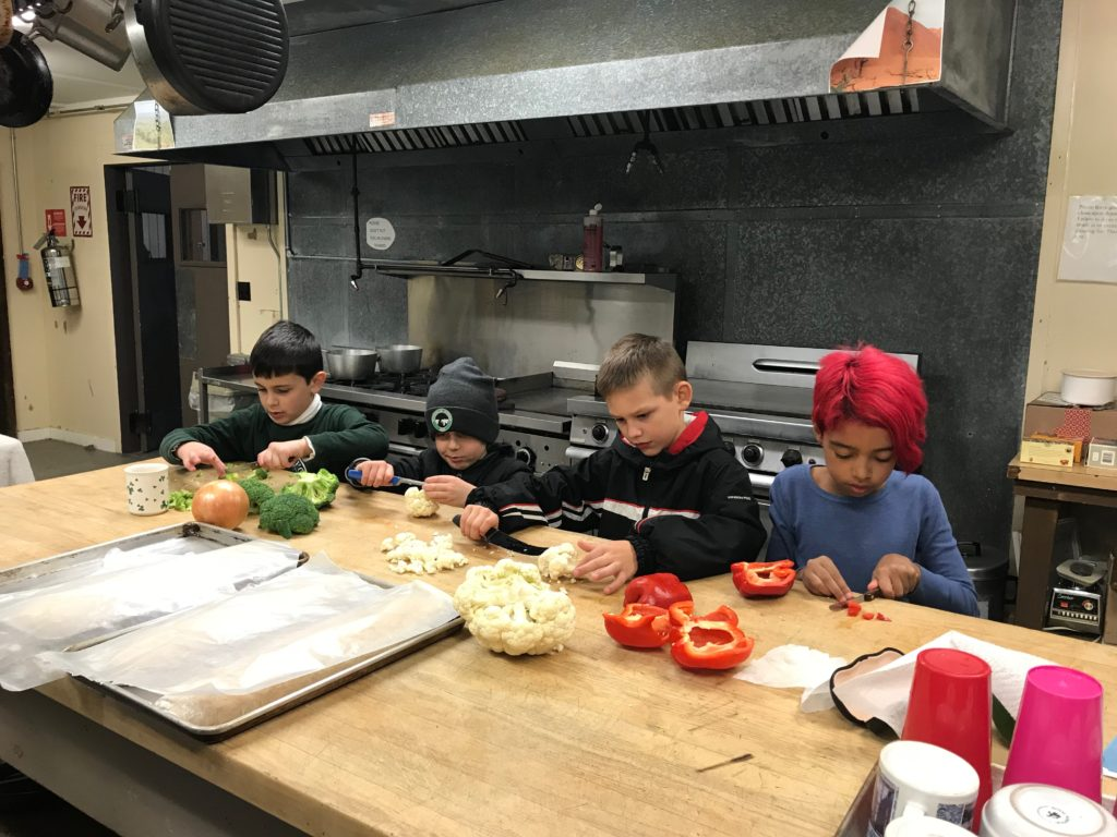helpers prepare dinner at Camp Allegany