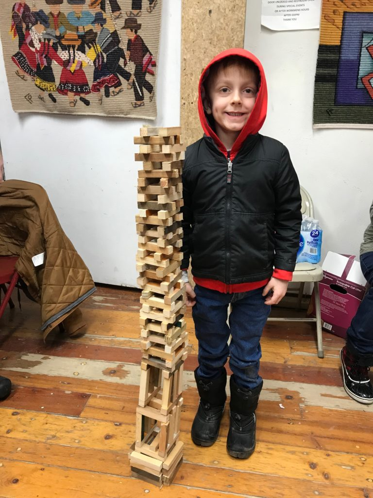 "Jackson next to his ""character tower"""