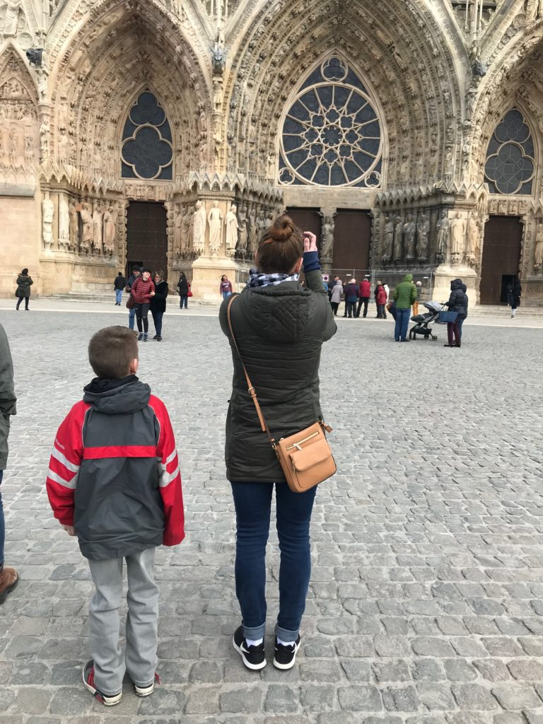 Jackson and his mom outside Notre Dame in Paris, France